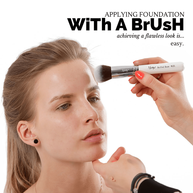 applying foundation with a brush